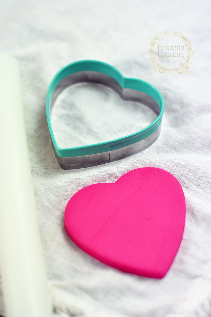 Create pink fondant ruffle hearts for cakes and cupcakes by Juniper Cakery