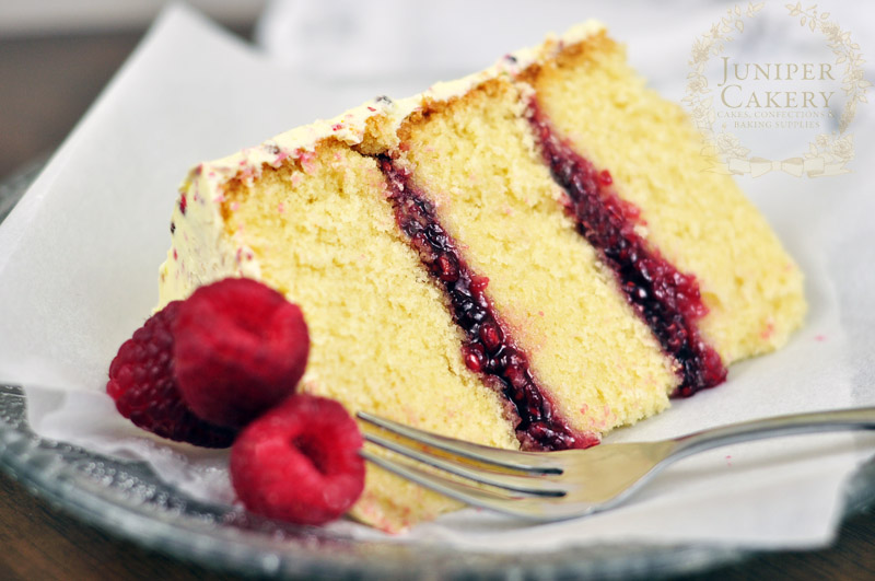 Slice of raspberry and pink peppercorn cake by Juniper Cakery
