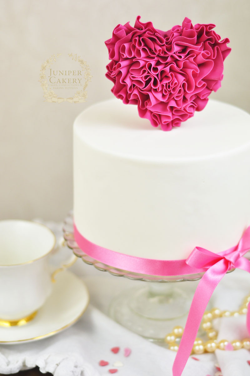 Tutorial on how to decorate a ruffle heart cake for Valentine's Day by Juniper Cakery
