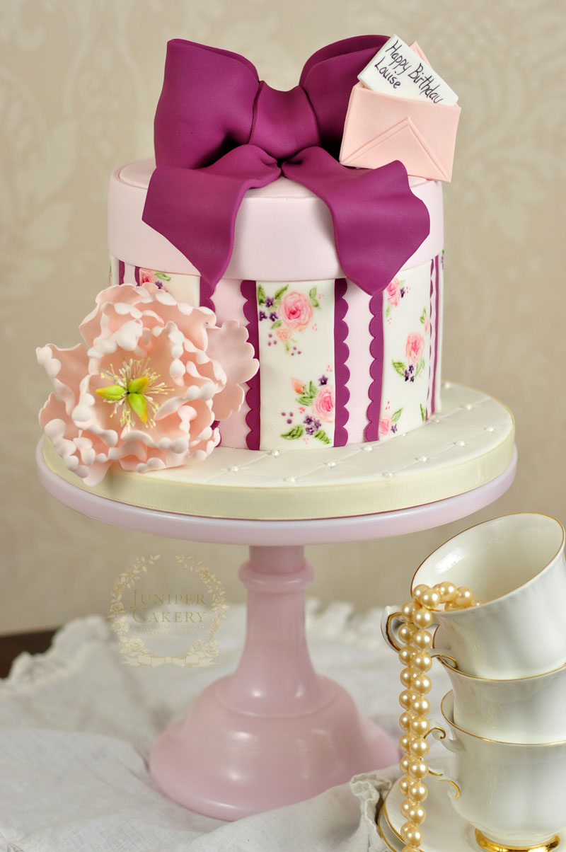 Pretty hand-painted peony and violet hat box cake by Juniper Cakery