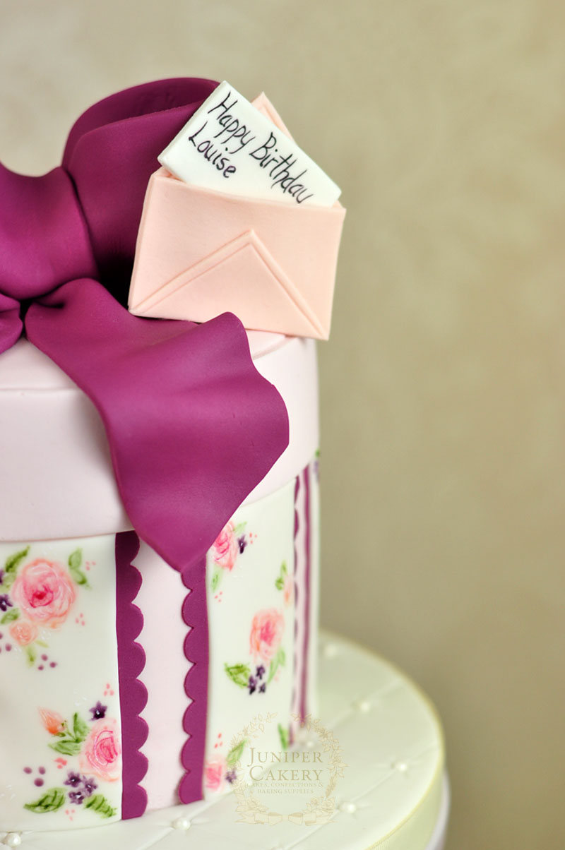 Purple, peach and blush vintage hat box cake by Juniper Cakery
