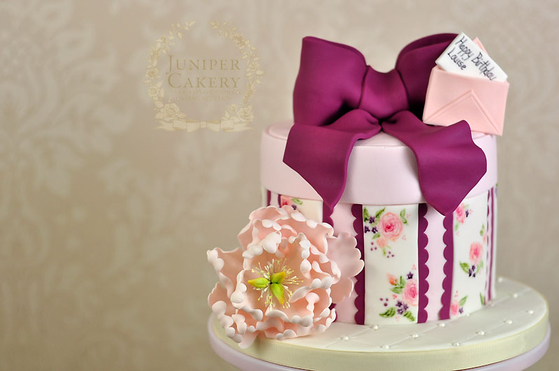 Hand-painted floral hat box cake by Juniper Cakery
