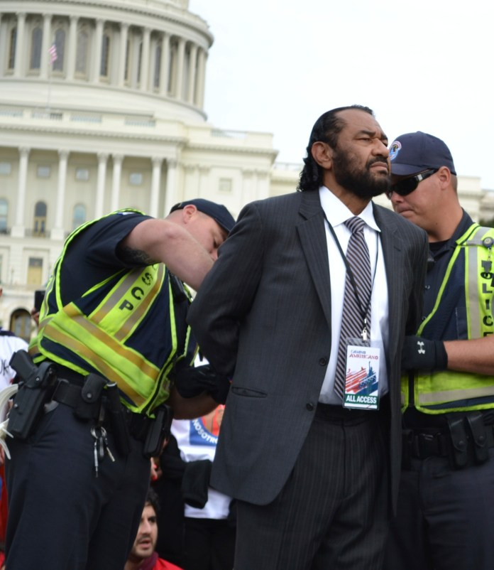 Congressman Al Green, of Texas, get's arrested by capitol police during a rally for immigration reform.