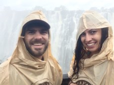 Standing on the bridge that overlooks Victoria Falls. Rain coats are provided because there is constant downpour this close to the falls.