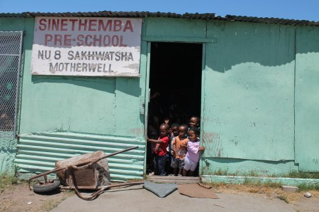 In the township outside of Red House more than 30 kids are taught by one woman in a plywood room in the middle of a dirt plot.