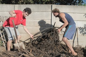Turning the compost pile is an every-other-day activity at 28 Towpath. This helps it to decompose and keeps the pipes for the composting shower hot.