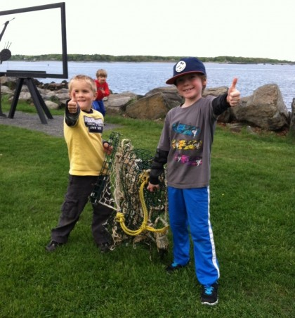 Evan and Henry hauling their beach finds up from the rocks.