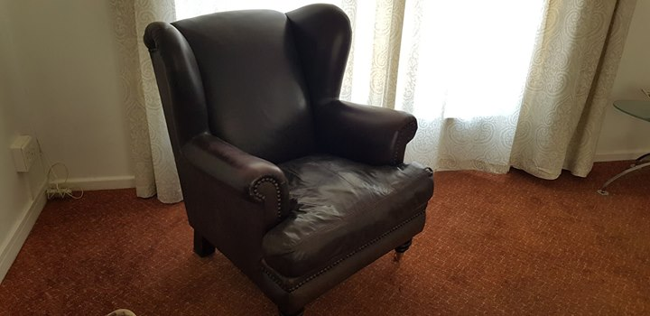 oxblood leather wing chair wrought iron glider studded wingback in excellent condition full grain all around junk mail