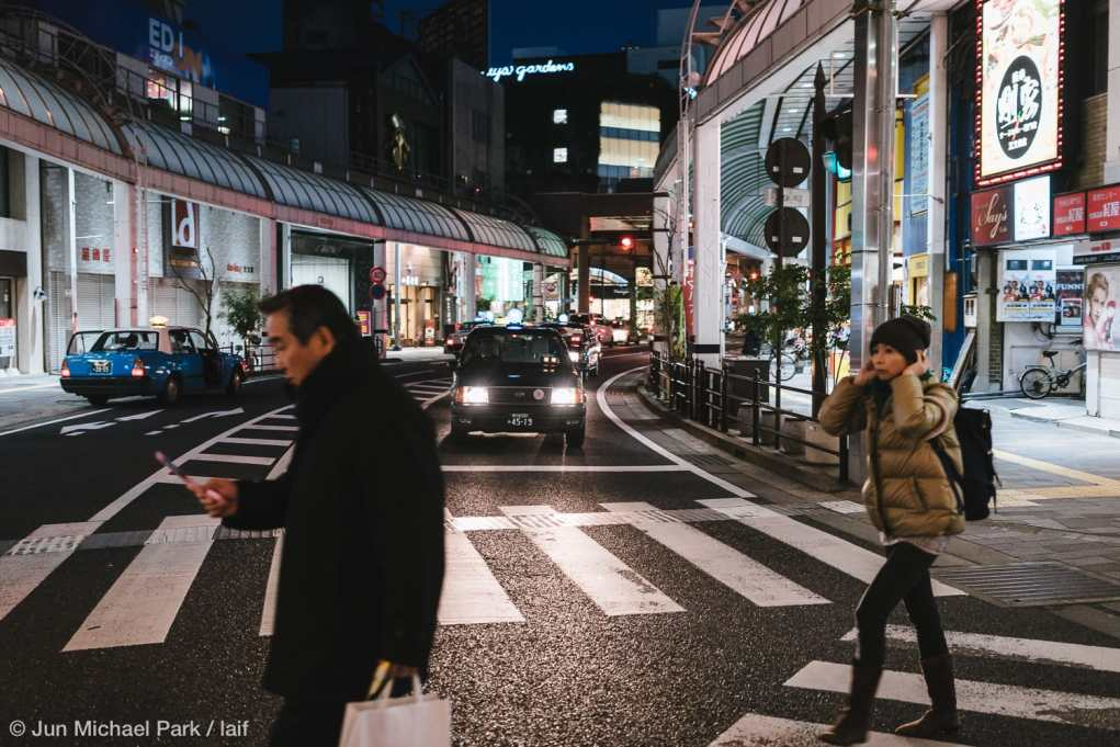 KAGOSHIMA, JAPAN - February 3, 2016: Locals cross a crosswalk in Tenmonkan, a bustling shopping and entertainment district in Kagoshima.