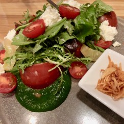 Heirloom tomato salad, nasturtium pesto, fromage frais, shallot vinaigrette and lemon cucumbers