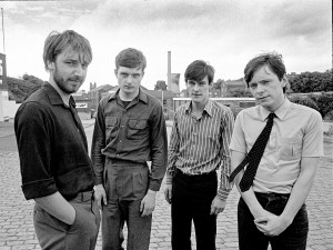 Picture By: Paul Slattery / Retna Pictures - Picture Shows: Portrait of Manchester band Joy Division photographed around Waterloo Road, Stockport, near Strawberry Studios. The band are Bernard Sumner (guitar and keyboards), Stephen Morris (drums and percussion), Ian Curtis (vocals and occasional guitar), Peter Hook (bass guitar and backing vocals). 28th July 1979. Its the 30th anniversary since Joy Division singer Ian Curtis committed suicide on May 18, 1980. - Job: 86474 Ref: PTY - World Rights *Unbylined uses will incur an additional discretionary fee!* **HIGHER RATES APPLY *