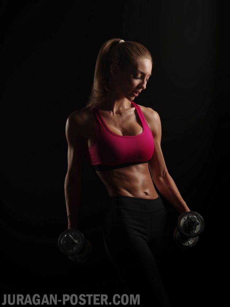 Beautiful Muscular Young Woman with Slim Fitness Body