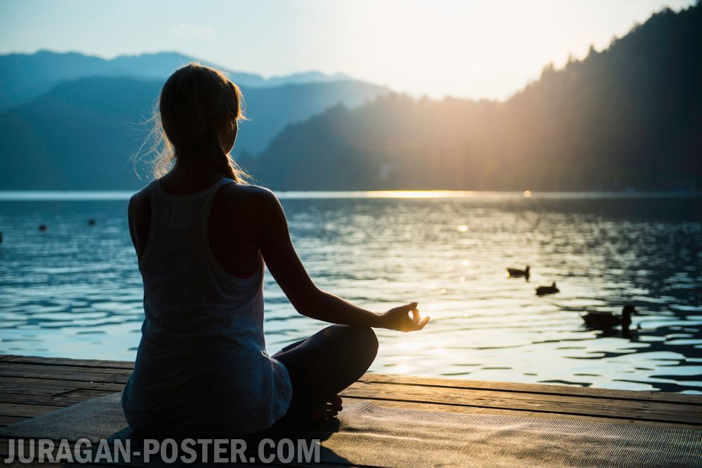 Woman doing yoga by the lake  Jual Poster di Juragan Poster