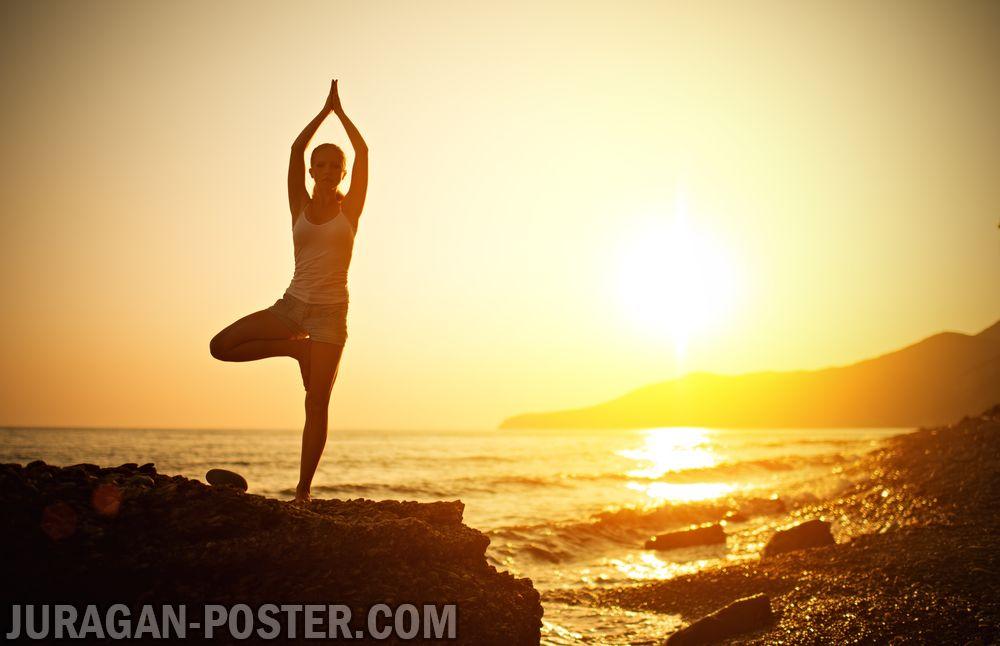 Yoga at sunset on beach  Jual Poster di Juragan Poster