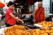 A monk buying tandoori chicken