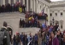 Sustinatorii lui Trump înarmați au luat cu asalt clădirea Capitoliului și intră în confruntări armate cu poliția