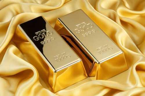 45451782 - gold bars on golden silk