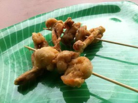 Deep fried frog meat skewer