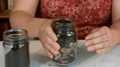 A jar filled with rocks, pebbles and dirt to represent priorities of putting in the big rocks or most important things first. Knowing your priorities will help you to thrive as a homeschool mom.