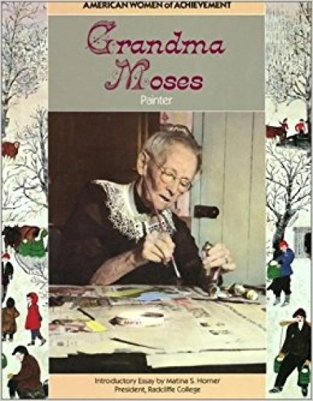 Cover of book with title Grandma Moses and photograph of old woman, Grandma Moses, painting a paper on a table in front of her.