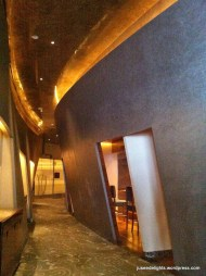 Slanted corridor that leads into several private teppanyaki rooms; Waku Ghin
