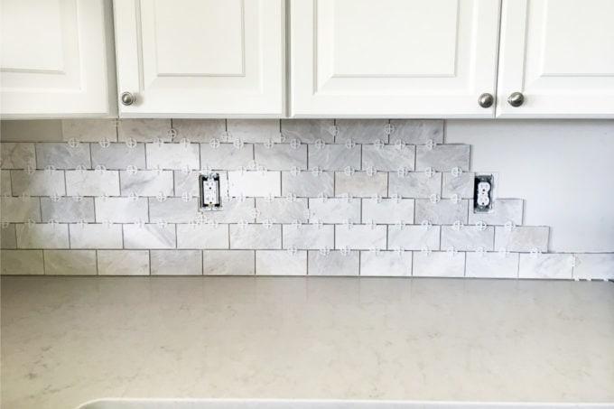 a marble subway tile backsplash