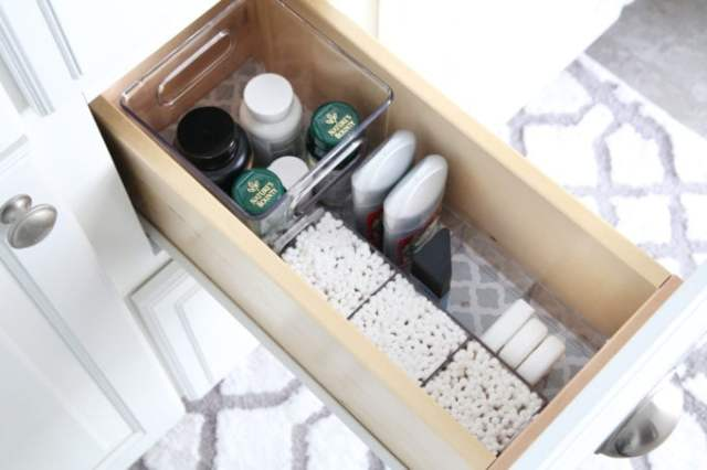 I'm sharing all of my favorite master bathroom organization ideas and some easy updates that we've done to take our master bathroom from cluttered and boring to organized and beautiful! | bathroom organization, organized bathroom vanity, how to organize a bathroom, how to organize deep vanity drawers, organized hair supplies, shaving tools organization, vitamins and q-tips in bathroom vanity drawer