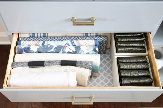Organized Table Runners and Placemats in a Dining Room Sideboard