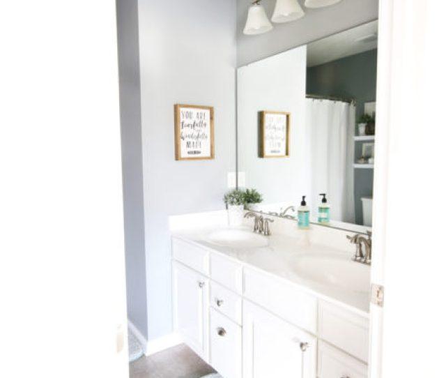 Guest Bathroom With White Vanity And Aqua Bath Mat