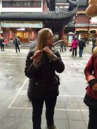 Playing a Chinese flute in Shanghai