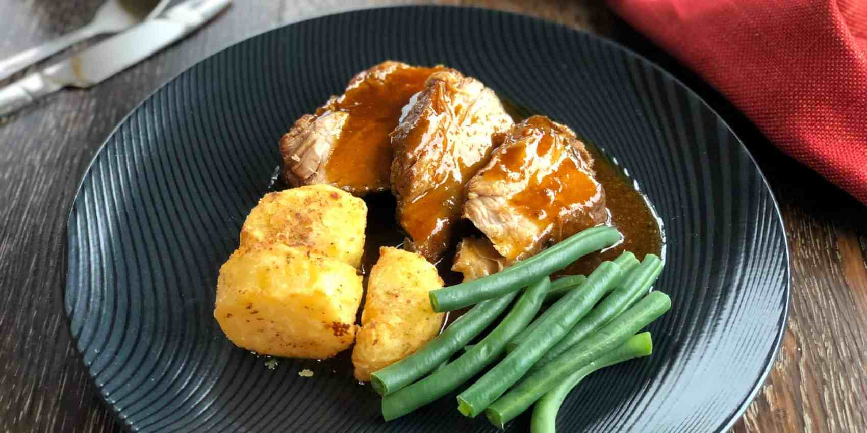 Delicious Perfect Roast Potatoes Served with Roast Pork