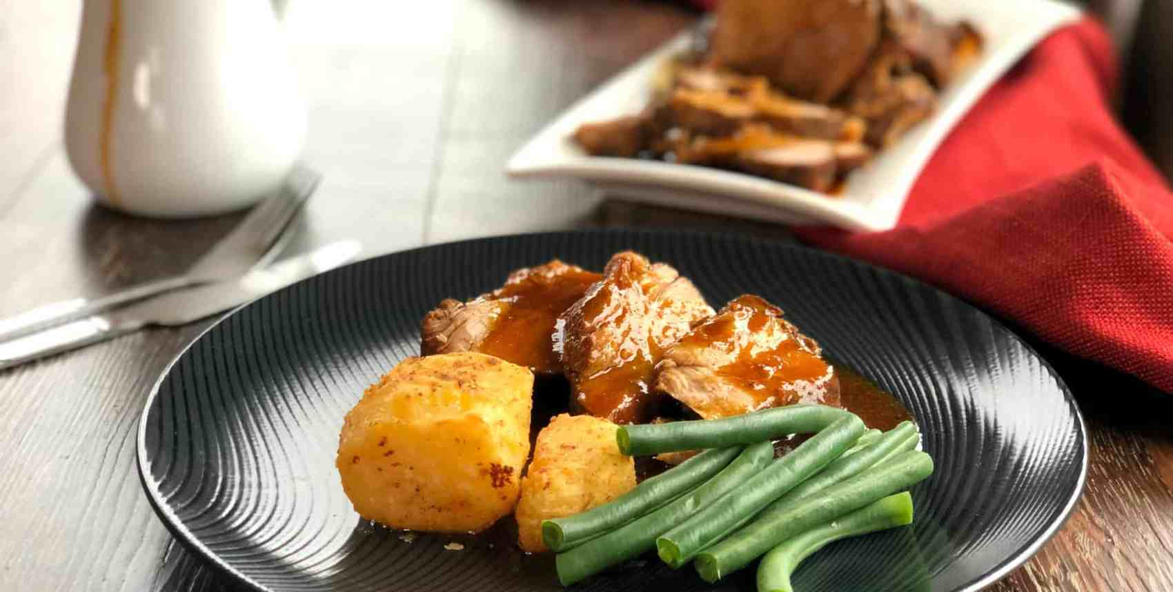 Roast Pork Dinner with Roast Potatoes and Green Beans