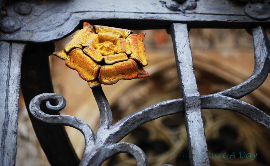 A metal flower adorns the gates of a cathedral.