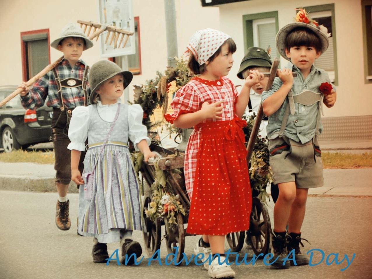 Children participate in the almabtrieb parade