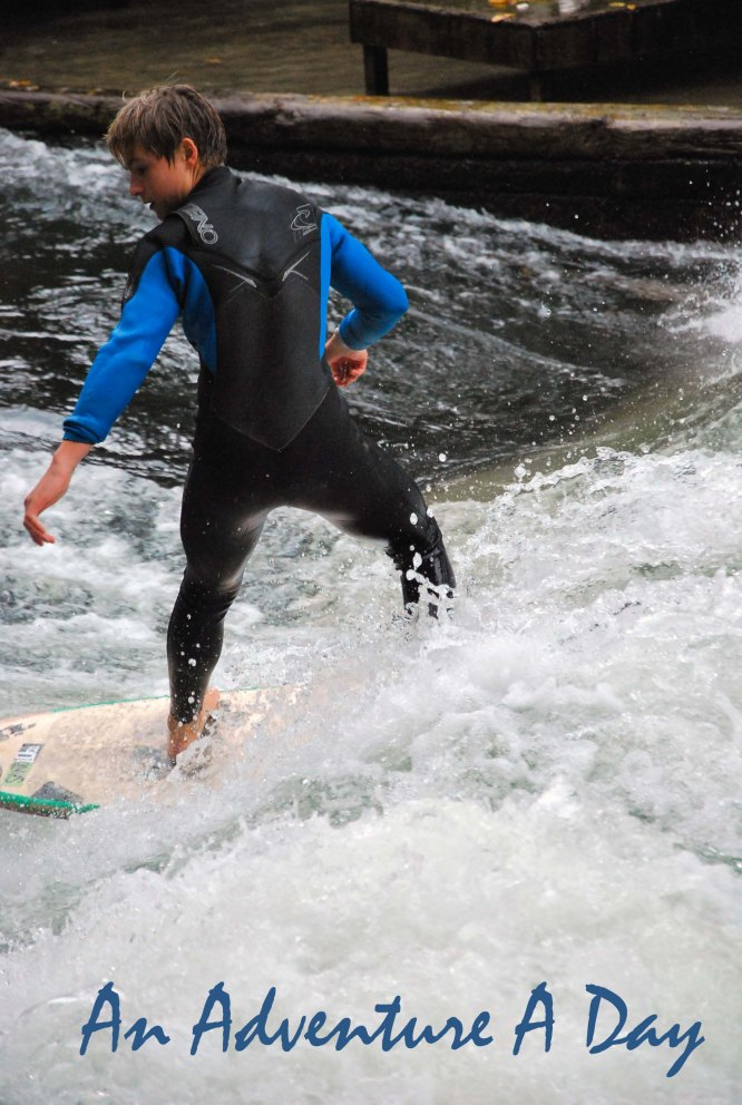 A surfer expertly moves from one bank to the other, above a manmade wave in the Eisbach Canal