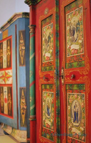Bavarian farmhouse style art is beautiful and functional. This wardrobe in Burglengenfeld's Folk Art Museum, depicts a variety of Catholic themes.