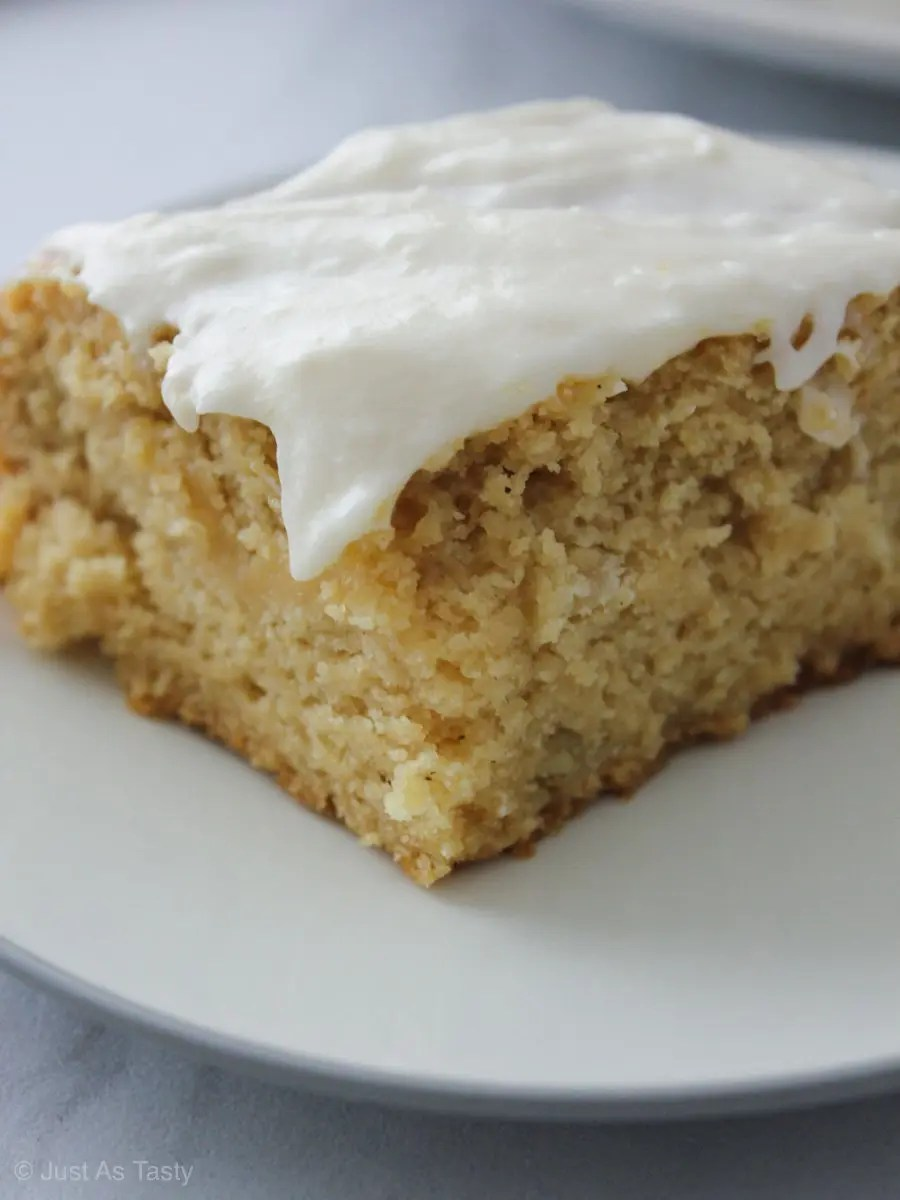 Soft and fluffy sour cream maple cake topped with a maple buttercream frosting.