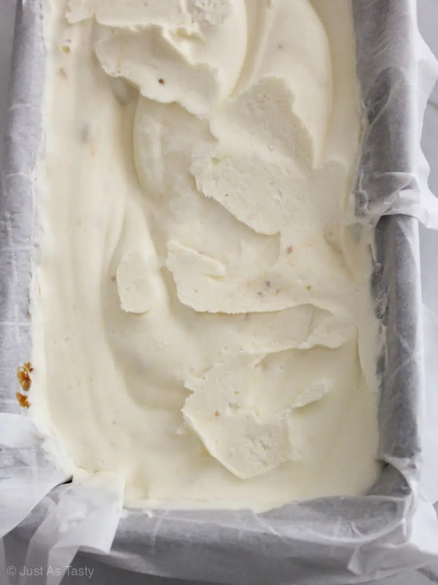Salted caramel ice cream without eggs in a loaf pan.