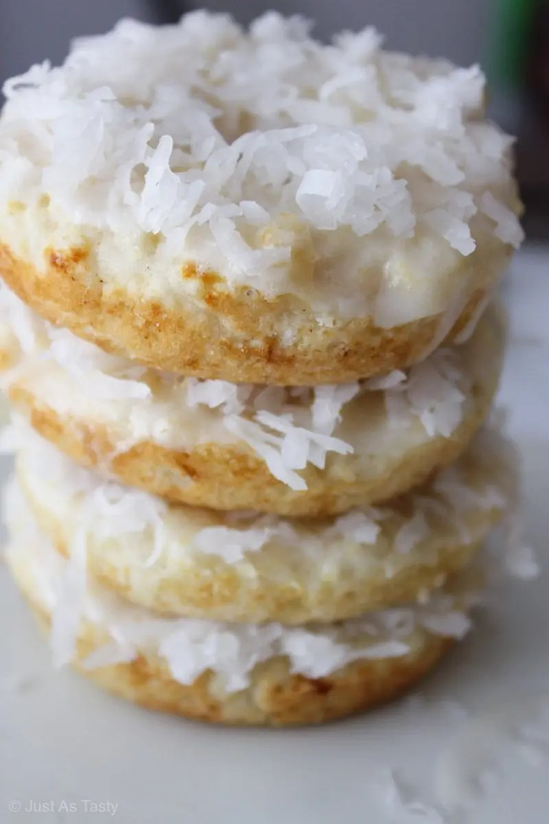 Stacked donuts topped with coconut flakes