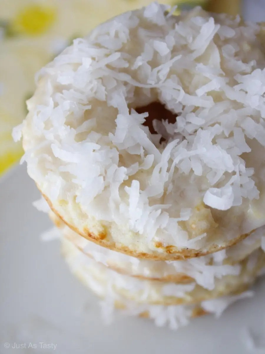 Close-up of stacked donuts topped with coconut flakes