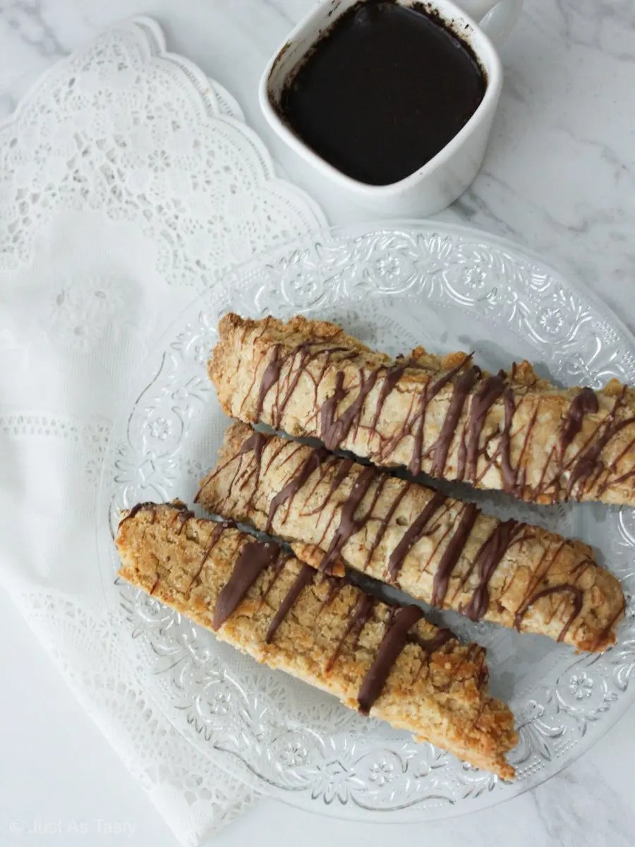 Chocolate drizzled biscotti on a white background.