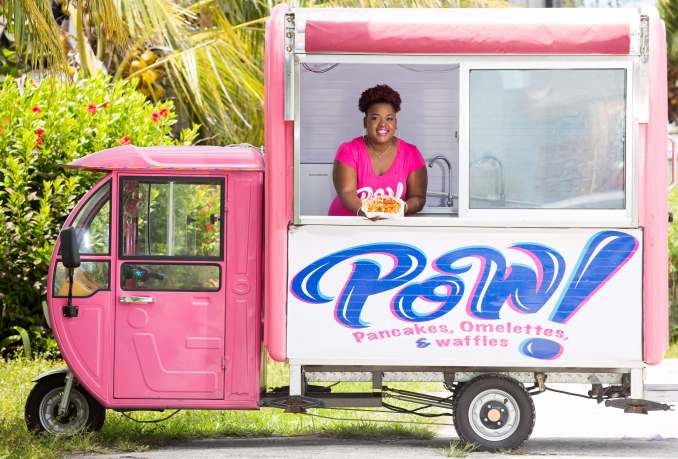 Photo 2- Xavia Rolle serving customers at POW! Food Truck popup brunch