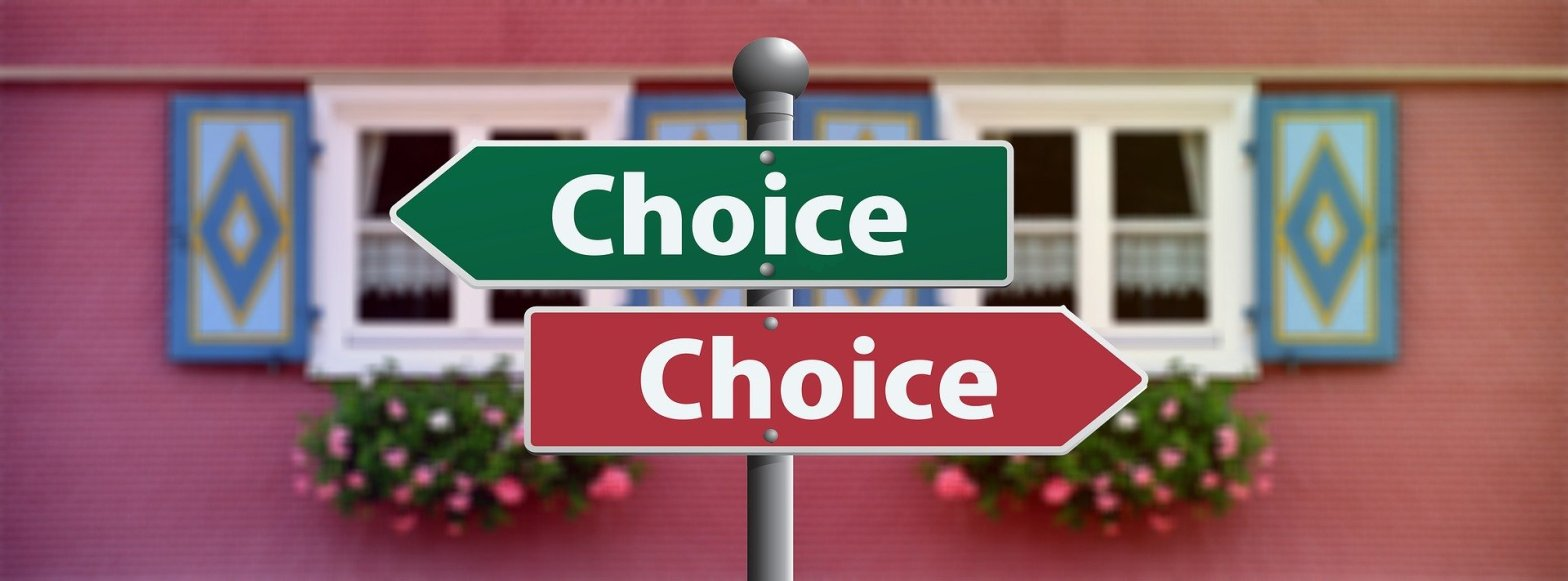 """two signs with the words """"choice"""" pointing opposite directions"""