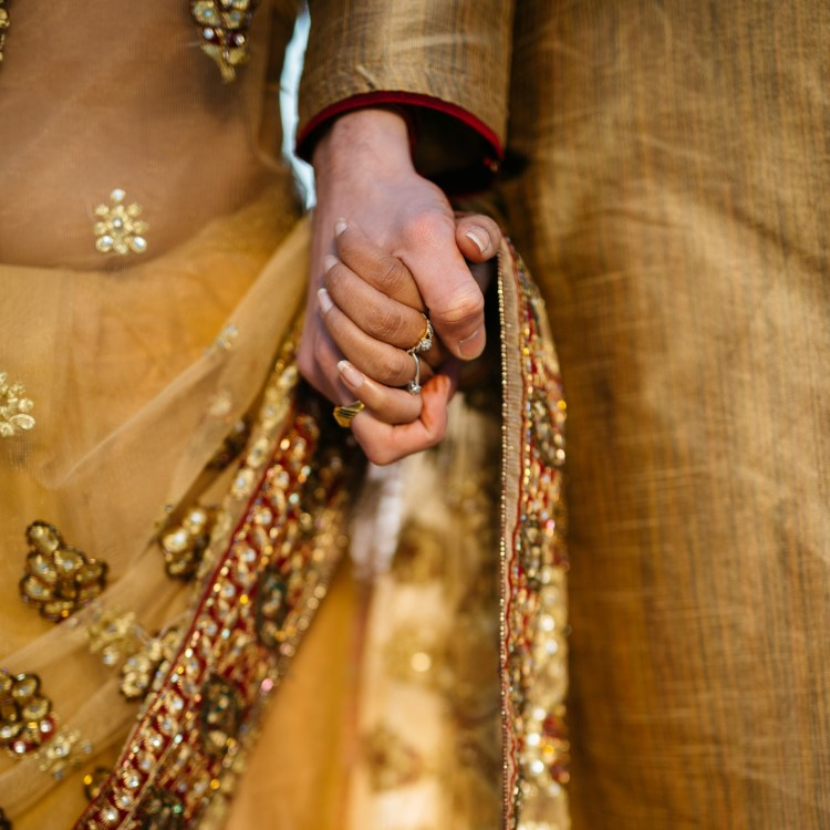 Middle Eastern wedding couple holding hands