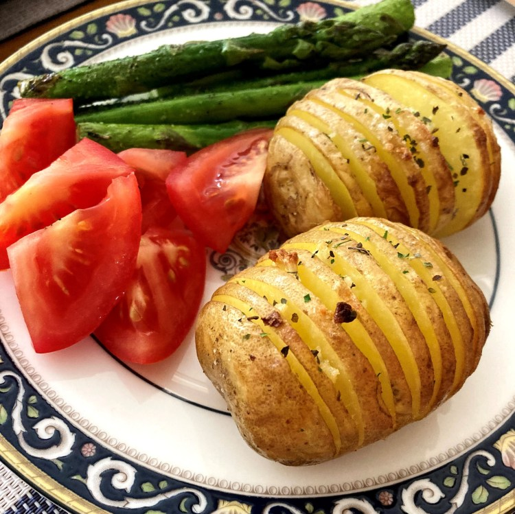 Hasselback Potatoes served with other veggies