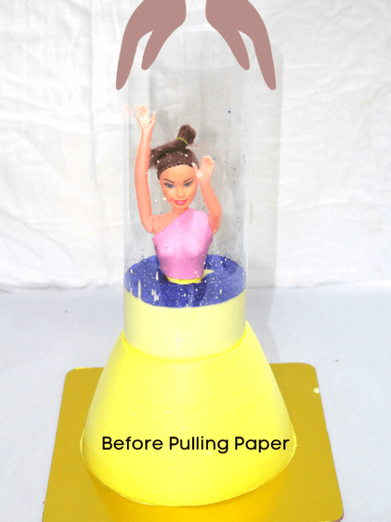 Pull me up doll cake in Pune