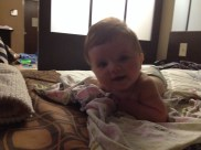 playing in hotel bed
