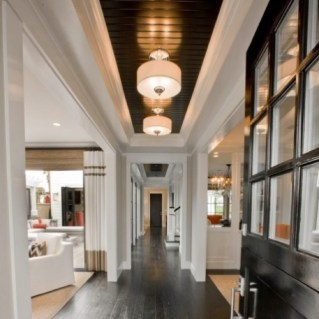 Ceiling treatment defines Hallway