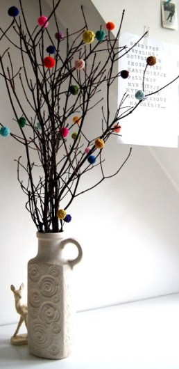Simple jug with knitted pompoms