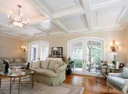 The coffered ceiling design is at home in either a traditional or contemporary space